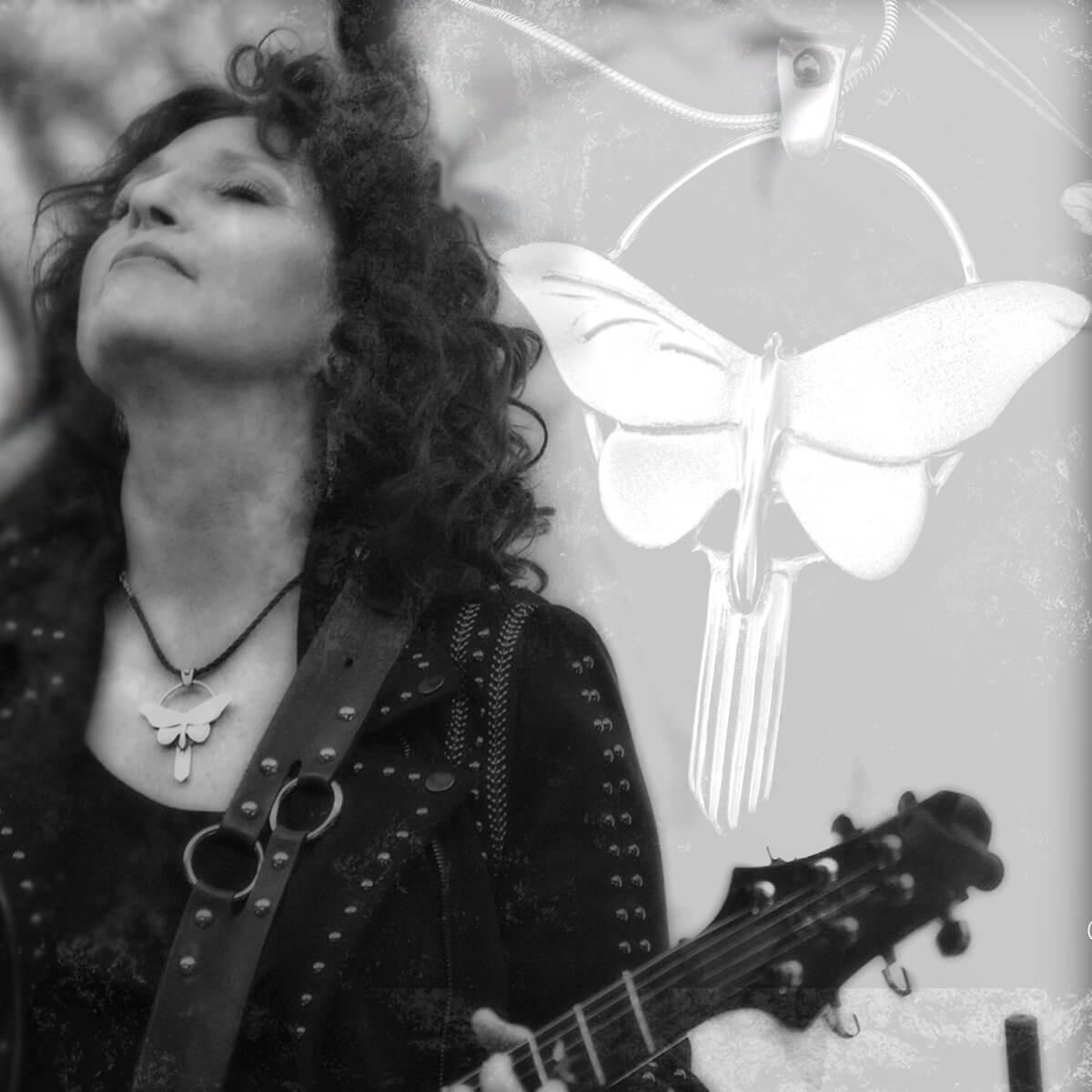 Valerie Romanoff wearing Dreams pendant on black cord